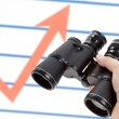 Black Binoculars and Market Chart — Stock Photo