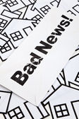 Bad News and Home Sign — Stock Photo