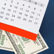 Calendar and dollar — Stock Photo