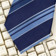 Blue Necktie and Keyboard — Stock Photo