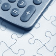 Stock Photo: Calculator and Puzzle