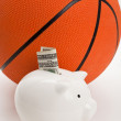 Stock Photo: Piggy Bank and basketball