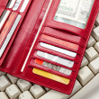 Red Wallet and keyboard — Stock Photo #7889673