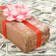 Prank gift and dollars - Stock Photo