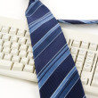 Blue Necktie and Keyboard — Stock Photo #7961657
