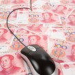 Chinese Yuan and Computer Mouse — Stock Photo