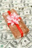 Prank gift and dollars — Stock Photo