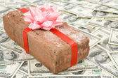 Prank gift and dollars — Stock Photo