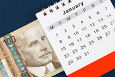 Calendar and Canadian dollar — Stock Photo