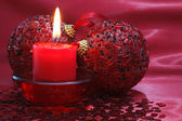 Candle and christmas balls. — Stock Photo