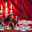 Christmas balls and candles. - Stock Photo