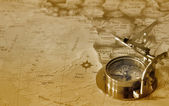 Old compass on e map — Foto Stock