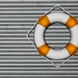 Lifebuoy attached to a metallic wall - Stock Photo