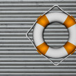 Lifebuoy attached to a metallic wall — Stock Photo #7718240