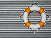 Lifebuoy attached to a metallic wall — Stock Photo