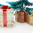 Christmas tree and the gifts — Stock Photo