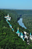 Monastery on the river — Stock Photo