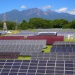 Stock Photo: Photovoltaic power plant and mountain