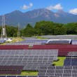 Photovoltaic power plant and mountain — Stock Photo