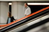 Moving down on an escalator — Stock Photo