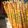 Stock Photo: Golden incense sticks in chinese temple