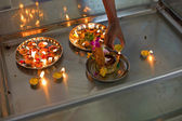Candle offeringg on a hindu temple — Stock Photo