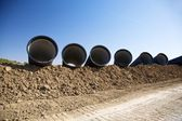 Pipelines on the mud — Stock Photo