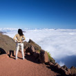 Постер, плакат: Cloud ocean and woman at La Palma