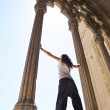 Woman between great columns — Stock Photo #6835033