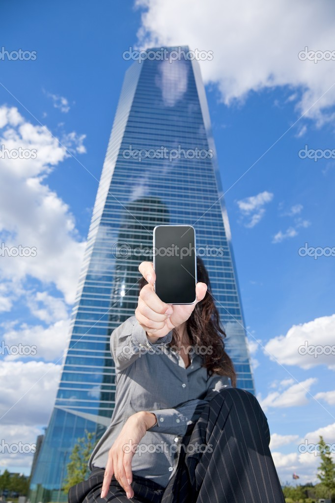 Business woman next to skyscrapers in Madrid city Spain — Stock Photo #6857795