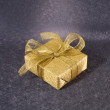 Golden gift box on blue background — Stock Photo #6918253