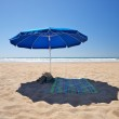 Lonely blue parasol — Stock Photo