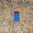 Sky view through an ancient window — Stock Photo