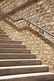 Stone steps with metal banister — Stock Photo