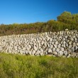 Wall of stones in Menorca - Stockfoto