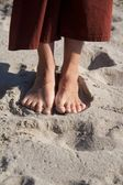 Woman feet on beach sand — Stock Photo