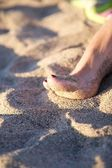 Varnish nail of woman foot — Stock Photo