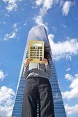 Calculator businesswoman and skyscraper — Stock Photo