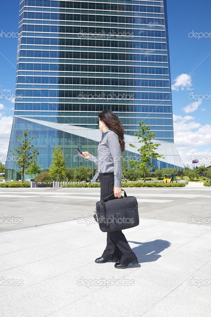 Business woman next to skyscrapers in Madrid city Spain — Stock Photo #7027888