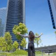 Business woman greeting skyscrapers — Stock Photo #7278441