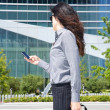 Businesswoman with smartphone on hand — Stock Photo #7278450