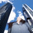 Woman looking at top skyscrapers — ストック写真