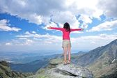 Cross arms winner woman at top rock — Stock Photo