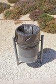 Black urban wastebasket — Stock Photo
