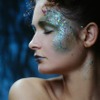 Beautiful woman with bright glitter makeup decorated for Christmas holiday — Stock Photo