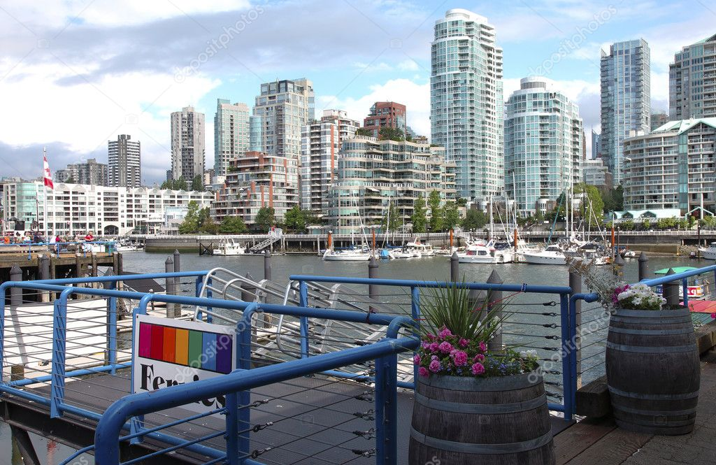 A ferry terminal in Granville island in Vancouver BC., Canada overlooking the skyline across False creek.  Stock Photo #6819315