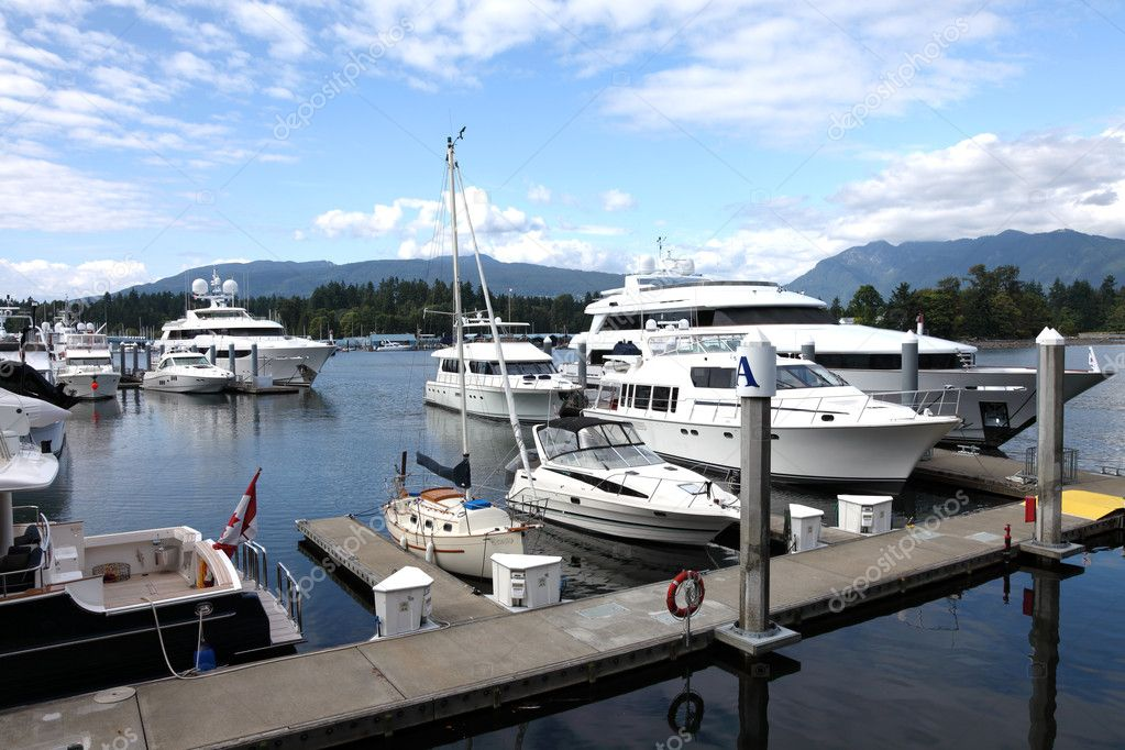 Luxury yachts & sailboat moored in a marina, Vancouver BC Canada. — Stock Photo #6936430