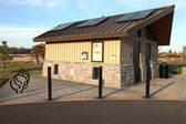 Solar panels on a park restroom facility. — Stock Photo