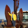 A woman & a large anchor. — Stock Photo
