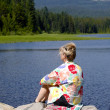 Stock Photo: Sitting on edge of lake.